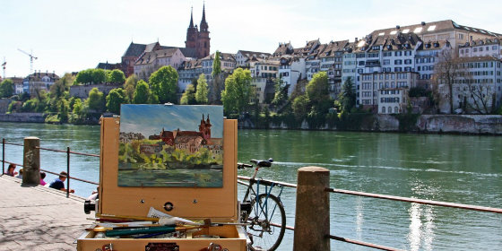 best-design-guide-Basel-Switzerland-City-Guide-painting-by-the-rhine-river-basel-switzerland